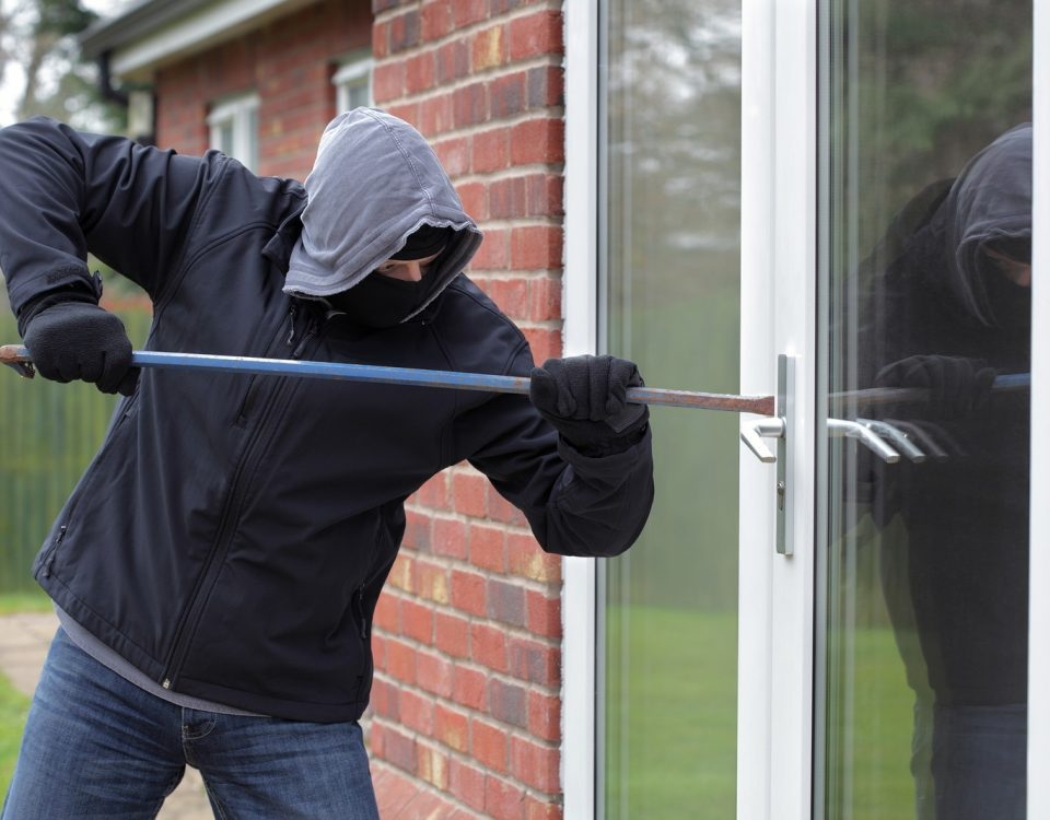 man breaking into a home